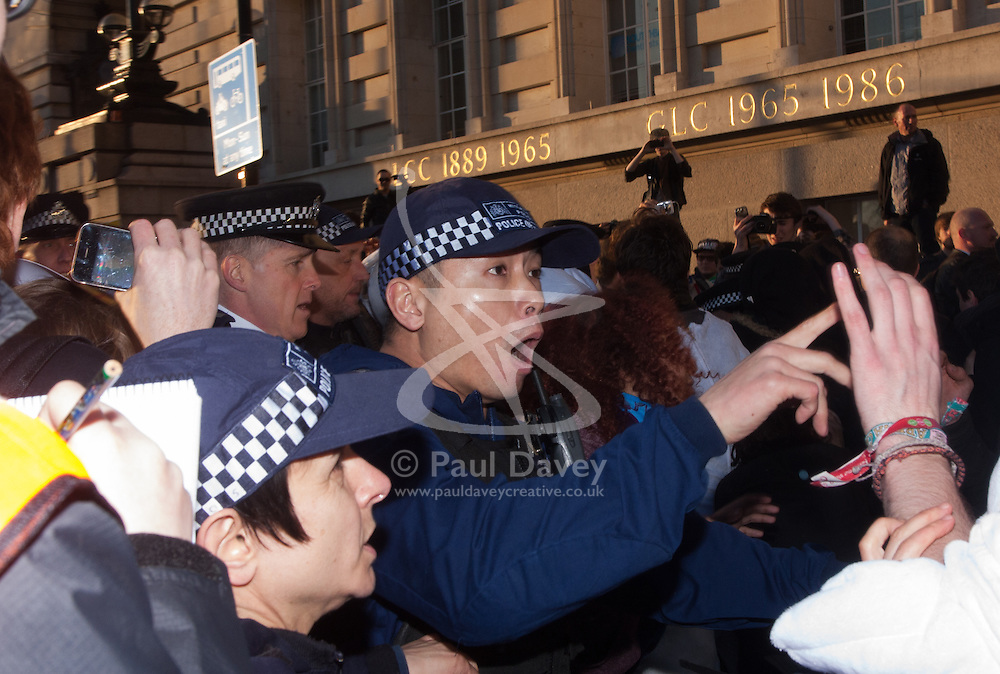 London, March 7th 2015. Following the Climate march through London, masked anarchists and environmental activists clash with police following a breakaway protest at Shell House. PICTURED: