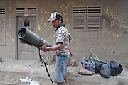 NORTH SULAWESI, INDONESIA - MAY 15: : <br /> <br /> Aftermath Eruption Mount Karangetang Volcano in North Sulawesi<br /> <br /> people clean there houses at Siau island aftermath eruption mount Karangetang volcano on May 12, 2015 in North Sulawesi, Indonesia. <br /> Nearly a week passed Since the biggest eruption on Thursday 7 May 2015 Karangetang volcano eruptions of hot clouds and lava. make hundreds of residents in the three mountain hamlets around the place safer displaced and hundreds dead livestock and fruit orchards, nutmeg citizens die. The worst impact is felt villagers Korakora.<br /> For residents in the area of Mount Karangetang known as Api Siau has a value of its own mystique. volcano located in the northern part of North Sulawesi, Indonesia precisely in Siau Island Regency Tagulandang Biaro (Sitaro). Mount Karangetang is one of the most active volcanoes in Indonesia with the eruption of more than 40 times since 1675 as well as many small eruptions that are not documented in historical records. in the notes eruption Karangetang occurred in 1997, 2010 and 2011 that killed three people.<br /> ©Fiqman Sunandar/Exclusivepix Media