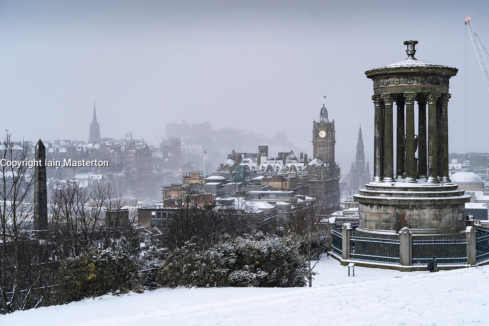 Edinburgh, Scotland, UK. 9 Feb 2021. Big freeze continues in the UK with Storm Darcy bringing several inches of snow to Edinburgh overnight. Pic; Blizzard blows across Edinburgh viewed from Calton Hill. Iain Masterton/Alamy Live news