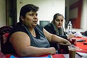 Volunteers Zaneta Mirgova (left) and Hana Gaborova during a meeting with volunteers for data collection regarding school enrolments in a backroom of a bar in Ostrava.
