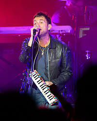 © Licensed to London News Pictures. 15/11/2014. London, UK.   Damon Albarn performing live at Royal Albert Hall with backing band The Heavy Seas.  Albarn is touring to promote his first solo record, Everyday Robots.   Photo credit : Richard Isaac/LNP