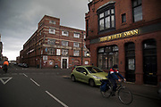 Storm clouds build over old red brick industrial buildings at the White Swan Pub in Digbeth, Birmingham, England, United Kingdom. Digbeth is an area of Central Birmingham, England. Following the destruction of the Inner Ring Road, Digbeth is now considered a district within Birmingham City Centre. As part of the Big City Plan, Digbeth is undergoing a large redevelopment scheme that will regenerate the old industrial buildings into apartments, retail premises, offices and arts facilities. There is still however much industrial activity in the south of the area.