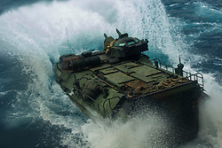 March 24, 2019 - Camp Hansen, Okinawa, Japan - An Assault Amphibious Vehicle with Battalion Landing Team, 1st Battalion, 4th Marines (BLT 1/4 ), splashes into the water off the amphibious transport dock USS Green Bay (LPD 20), underway in the Pacific Ocean. BLT 1/4 is the Ground Combat Element for the 31st Marine Expeditionary Unit. The 31st MEU, the Marine Corps' only continuously forward-deployed MEU, provides a flexible and lethal force ready to perform a wide range of military operations as the premier crisis response force in the Indo-Pacific region. (Credit Image: © U.S. Marine Corps/ZUMA Wire/ZUMAPRESS.com)