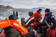 Zbigniew Sobierajski drives a motorboat transporting new arrivals to the Polish Polar Station in Hornsund, Svalbard.