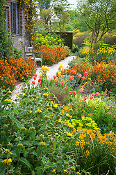 Tulips and wallflowers in The Cottage garden at Sissinghurst Castle in spring