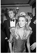 Daphne Guinness. Robin Hurlestone behind. Charity Ball in aid of Centrepoint. Cafe de Paris. 16 December 1986. SUPPLIED FOR ONE-TIME USE ONLY> DO NOT ARCHIVE. © Copyright Photograph by Dafydd Jones 66 Stockwell Park Rd. London SW9 0DA Tel 020 7733 0108 www.dafjones.com