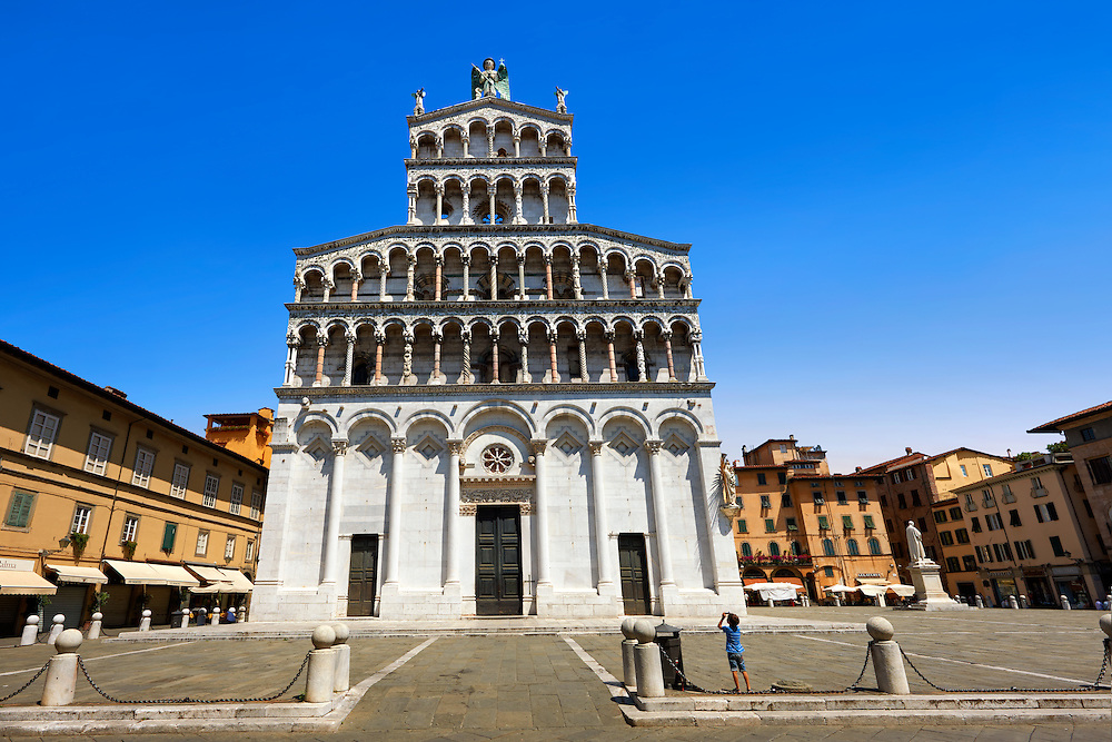 13th century Romanesque facade of the San Michele in Foro is a Roman Catholic basilica church in Lucca, Tunscany, Italy . .<br /> <br /> Visit our ITALY PHOTO COLLECTION for more   photos of Italy to download or buy as prints https://funkystock.photoshelter.com/gallery-collection/2b-Pictures-Images-of-Italy-Photos-of-Italian-Historic-Landmark-Sites/C0000qxA2zGFjd_k<br /> <br /> If you prefer to buy from our ALAMY PHOTO LIBRARY  Collection visit : https://www.alamy.com/portfolio/paul-williams-funkystock/lucca.html .<br /> <br /> Visit our MEDIEVAL PHOTO COLLECTIONS for more   photos  to download or buy as prints https://funkystock.photoshelter.com/gallery-collection/Medieval-Middle-Ages-Historic-Places-Arcaeological-Sites-Pictures-Images-of/C0000B5ZA54_WD0s