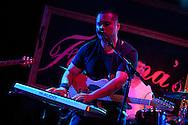 Closeup of Jon Ho playing keyboard at Deacons Hail CD release party at Fontana's Bar