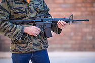 A Bushmaster AR-15,semi-automatic rifle, the type of gun the killer used in the Sandy school massacre in Connecticut has been labeled an assault weapon by gun control advocacy groups. . The mass shooting involving twenty children started a national debate for and against gun control in American