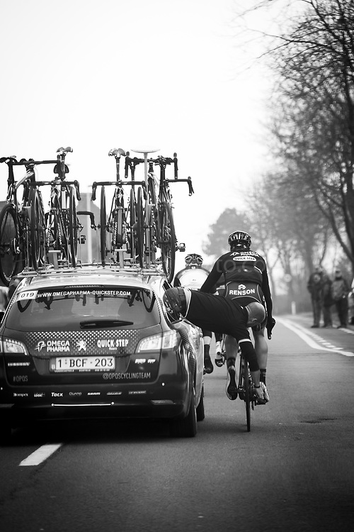 The view from the Commissaire's car - the race referee. Brabantse Pijl 2013, a spring semi-classic cycle race which takes place in the Flemish Brabant region of Belgium. April 10, 2013