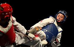 Great Britain's Jade Jones (right) on her way to winning her semi final match against Canada's Skylar Park, during day three of the WTF World Taekwondo Grand Prix 2018 at the Regional Arena, Manchester.
