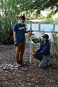 Charlie and Nichole taking measurements.