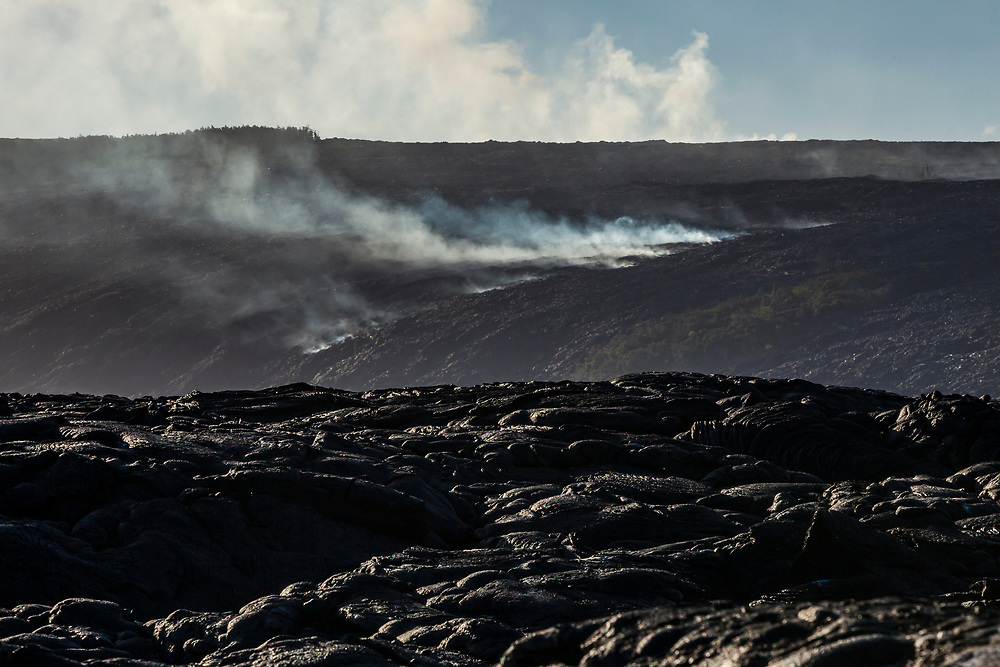 Steam and gas seep up from volcanic activity below on the Eastern Rift Zone in Pune, Hawaii, USA.