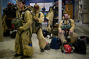 Smokejumpers at the McCall, ID smokejumper base perform last minute checks before they embark on a training exercise.
