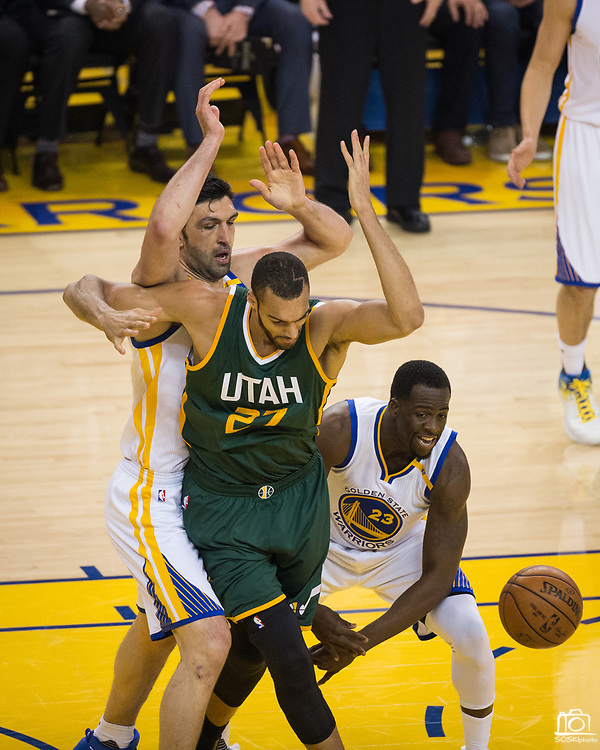 Golden State Warriors forward Draymond Green (23) strips the ball from Utah Jazz center Rudy Gobert (27) during Game 1 of the Western Conference Semifinals at Oracle Arena in Oakland, Calif., on May 2, 2017. (Stan Olszewski/Special to S.F. Examiner)