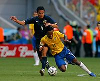 Photo: Glyn Thomas.<br />Brazil v Australia. Group F, FIFA World Cup 2006. 18/06/2006.<br /> Australia's Tim Cahill (L) and Brazil's Ze Roberto.