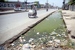 July 4, 2017 - Pakistan - PESHAWAR, PAKISTAN, JUL 04: A view of open sewerage water drain that fills with .polythene bags, bushes and garbage needs the attention of concerned department at Charsadda .road in Peshawar on Tuesday, July 04, 2017. (Credit Image: © PPI via ZUMA Wire)