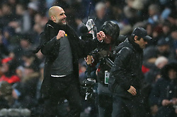Manchester City manager Pep Guardiola (left) celebrating after the final whistle while Chelsea manager Antonio Conte walks off looking dejected during the Premier League match at the Etihad Stadium, Manchester.