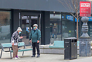 1st March, Cheltenham, England. A man and woman stand in Cheltenham town centre during the third national lockdown.
