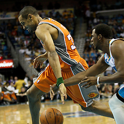 April 8, 2011; New Orleans, LA, USA; New Orleans Hornets point guard Chris Paul (3) steals the ball from Phoenix Suns small forward Grant Hill (33) during the third quarter at the New Orleans Arena. The Hornets defeated the Suns 109-97.   Mandatory Credit: Derick E. Hingle