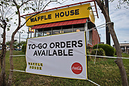 April 4, 2020, New Orleans, Louisiana - The Waffle House on Old Gentilly Rd open only for takeout while the COVID-19 Pandemic worsens.