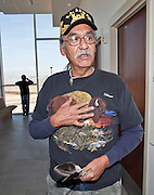 """04 FEBRUARY 2010 - CAMP VERDE, AZ: J.R. Packhorse, representing the Intertribal Eagle Feather Council and  Lakota Nation talks about Native American interests in the James Arthur Ray case. Packhorse said he was there to observe the proceeding to make sure Native interests and common law interests coincided. He said Ray had violated Native traditions by using a sacred ceremony to make money. He said that in traditional culture you presented a small gift to leader of the ceremony but didn't pay him. And that the sweat lodge ceremony is a life giving ceremony but that Ray had, allegedly, taken lives during the ceremony.  Ray was arrested in Prescott, AZ, on Feb 3 and charged with three counts of manslaughter after three people died during a sweat lodge ceremony he was holding in Sedona, AZ, in October 2009. The ceremony was a part of a """"Spiritual Warrior"""" workshop Ray was leading. He charged participants $8,000 each. James Arthur Ray had his initial appearance in Yavapai County Court in Camp Verde Thursday morning. His bail was set at $5 Million Dollars (US). Ray did not post bail and remains in jail. PHOTO BY JACK KURTZ   NO SALES"""