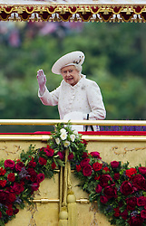 © Licensed to London News Pictures. 03/06/2012. London, UK. HRH The Queen boarding the Royal Barge Spirit of Chartwell at Cadogan Pier during the Jubilee Pageant on the River Thames, London on June 03,2012 as part of The Diamond Jubilee celebrations. Great Britain is celebrating the 60th  anniversary of the countries Monarch HRH Queen Elizabeth II accession to the throne . Photo credit : Ben Cawthra/LNP