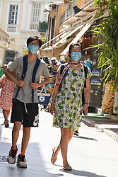 © Licensed to London News Pictures. 30/08/2020. Athens, Greece. Tourists wear face coverings as they walk in central Athens. Greece could be put on the UK quarantine list after a spike in coronavirus cases. Photo credit: Ioannis Alexopoulos/LNP