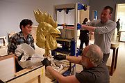 From left to right: Daniel Glendenning, Steve Short  and Evan Tewinkel carefully move a rooster head on May 19, 2015, part of an exhibition of Ai Weiweiís Circle of Animals/Zodiac Heads: Gold (2010) that will be on display for the summer in the Arlene and Harold Schnitzer Sculpture Court at the Portland Art Museum. Randy L. Rasmussen/Staff