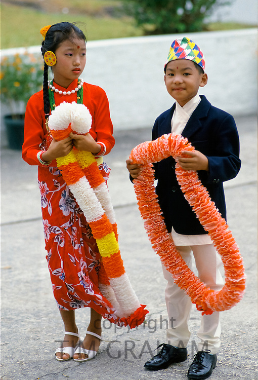 Nepalese children in traditional costumes with traditional welcome garlands
