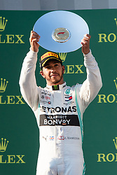 March 17, 2019 - Albert Park, VIC, U.S. - ALBERT PARK, VIC - MARCH 17: Mercedes-AMG Petronas Motorsport driver Lewis Hamilton (44) holds up the second place trophy at The Australian Formula One Grand Prix on March 17, 2019, at The Melbourne Grand Prix Circuit in Albert Park, Australia. (Photo by Speed Media/Icon Sportswire) (Credit Image: © Steven Markham/Icon SMI via ZUMA Press)