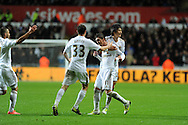 Swansea city's Pablo Hernandez © celebrates with Ben Davies and Ki Sung-Yueng after he scores the equalising goal to make it 1-1.    Barclays Premier league, Swansea city v Chelsea at the Liberty Stadium in Swansea, Swansea, South Wales on Saturday 3rd November 2012. pic by Andrew Orchard, Andrew Orchard sports photography,