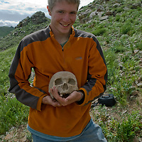 MONGOLIA. Nick Wiltsie holds bronze-age skull that may be 2700+ years old.