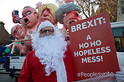 Anti Brexit pro Europe demonstrator dressed up as Santa Claus in Westminster opposite Parliament on 12th December 2018 in London, England, United Kingdom.