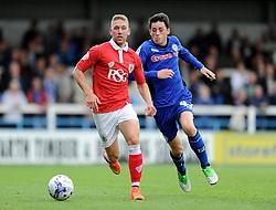 Bristol City's Scott Wagstaff is chased down by Rochdale's Ian Henderson - Photo mandatory by-line: Dougie Allward/JMP - Mobile: 07966 386802 23/08/2014 - SPORT - FOOTBALL - Manchester - Spotland Stadium - Rochdale AFC v Bristol City - Sky Bet League One