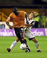 Photo: Dave Linney.<br />Wolverhampton Wanderers v Preston North End. Coca Cola Championship. 11/08/2006.Wolves's Seyi Olofinjana(L) evades the challenge of  Paul McKenna