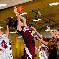 022513     Brian Leddy<br />  Ramah Mustang Jordyn Lewis (3) reaches above the fray to grab a rebound during Monday night's district playoff game against Rehoboth.