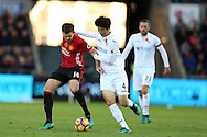 Michael Carrick of Manchester Utd (l) holds off Ki Sung-Yueng of Swansea city.Premier league match, Swansea city v Manchester Utd at the Liberty Stadium in Swansea, South Wales on Sunday 6th November 2016.<br /> pic by  Andrew Orchard, Andrew Orchard sports photography.