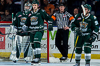 KELOWNA, BC - FEBRUARY 28: Referee Brett Iverson stands at the net of  Dustin Wolf #32 as  Kasper Puutio #4 and Dawson Butt #9 of the Everett Silvertips watch for the line up against the Kelowna Rockets at Prospera Place on February 28, 2020 in Kelowna, Canada. (Photo by Marissa Baecker/Shoot the Breeze)