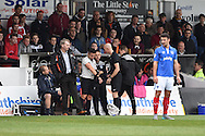Referee James Adcock (c blk hair) is replaced by 4th official  Wayne Barratt ® late in 1st half. Skybet football league two match, Newport county v Portsmouth at Rodney Parade in Newport, South Wales  on Saturday 17th October 2015.<br /> pic by  Andrew Orchard, Andrew Orchard sports photography.
