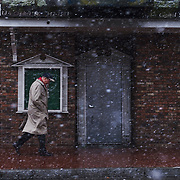 A man walks down Capitol street amidst a squall in Charleston, W.Va., on Tuesday, December 12, 2017.