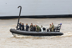 © Licensed to London News Pictures. 23/10/2018. London, UK. Royal Marines in a RIB with a ladder during a rehearsal for a display tomorrow when the Royal Marines and Royal Netherlands Marines will stage a joint on water capability demonstration with blank ammunition. As part of the Dutch state visit, King Willem-Alexander and Queen Máxima will attend the Dutch ship HNLMS Zeeland, which is anchored next to HMS Belfast. They will join The Duke of Kent on board and will be given a 10 minute display of the Royal Marines and Royal Netherlands Marines staging a joint on water capability demonstration.Photo credit: Vickie Flores/LNP