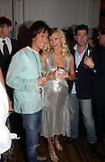 Andy Wong and Paris Hilton. Paris Hilton's Fragrance Launch Party at Il Bottaccio, Grosvenor Place. London. 16 May 2005. . ONE TIME USE ONLY - DO NOT ARCHIVE  © Copyright Photograph by Dafydd Jones 66 Stockwell Park Rd. London SW9 0DA Tel 020 7733 0108 www.dafjones.com