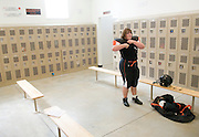 NEWS&GUIDE PHOTO / PRICE CHAMBERS.Heidi Schmillen changes out of her uniform alone in the girls locker room on Sept. 19 after the junior varsity game against Rawlins.