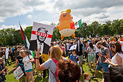 The six metre high inflatable TrumpBaby balloon flying high at the demo on the Meadows in Edinburgh, Scotland. United Kingdom. 14th July 2018.