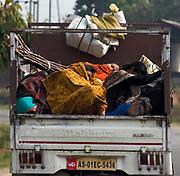 People sleeping on a download plan near Guwahati, Assam, India.