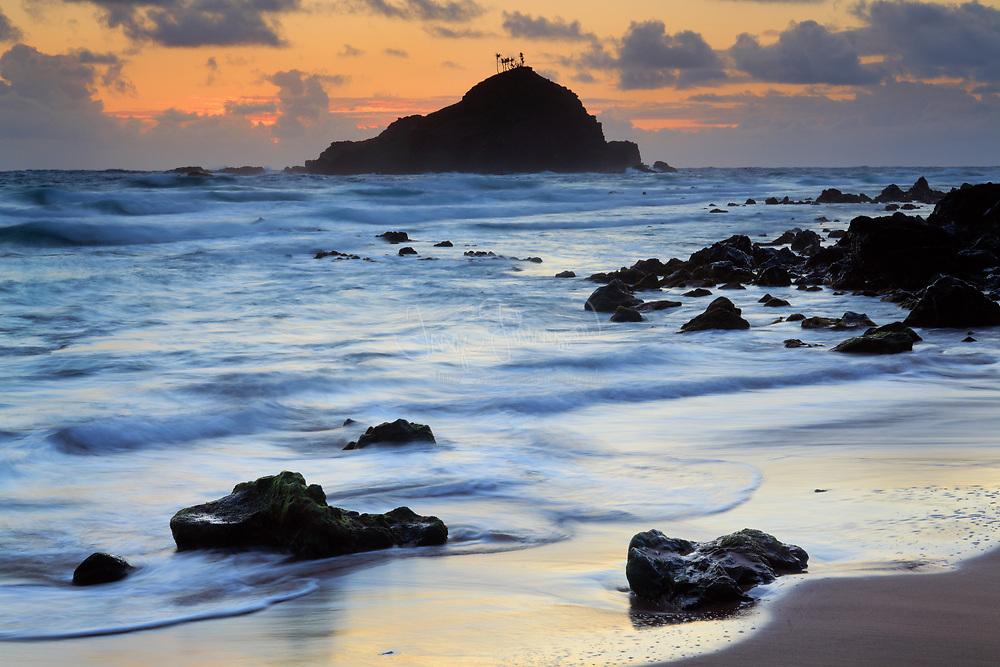 Sunrise at Koki Beach in the town of Hana in Hawaii's Maui island