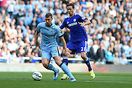 Edin Dzeko of Manchester city breaks away from Nemanja Matic of Chelsea..Barclays premier league match, Manchester city v Chelsea at the Etihad stadium in Manchester,Lancs on Sunday 21st Sept 2014<br /> pic by Andrew Orchard, Andrew Orchard sports photography.