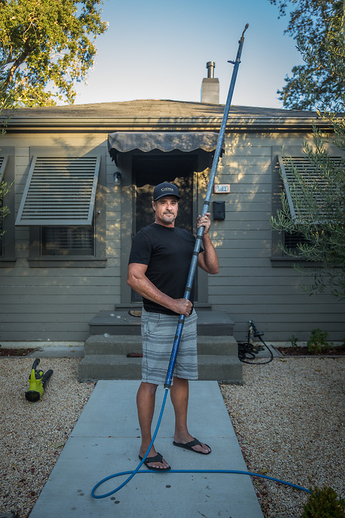 """""""I need to catch up on the maintenance of my tools.""""  -All American Power Wash owner Monte Cobb stands in front of his Calistoga home with his power washer extension."""