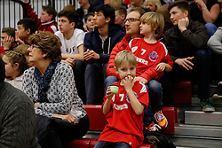 A young member of the crown looks on nervously - Photo mandatory by-line: Rogan Thomson/JMP - 07966 386802 - 13/02/2015 - SPORT - BASKETBALL - Bristol, England - SGS Wise Arena - Bristol Flyers v Surrey United - BBL Championship.